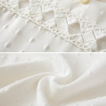 รหัส A34 เสื้อผ้าชีฟองสีขาว ประดับมุกรอบคอ แขนทั้งสองข้างประดับด้วยผ้าโปร่งลูกไม้